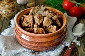 picture of stew  - Beef stew with Bay leaf and pepper on wooden table - JPG