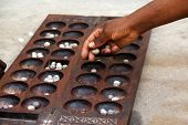 picture of arabic  - Hand playing Mancala game  - JPG