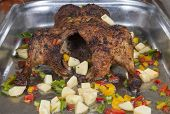 image of roast duck  - Whole roasted duck with vegetables on display at a hotel restaurant buffet - JPG
