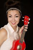 pic of ukulele  - Beautiful teen girl holding red ukulele smiling - JPG