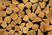foto of firewood  - Stack of firewood for the textured background pattern - JPG