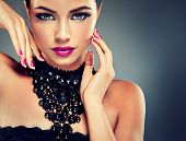 foto of black eyes  - Beautiful Model with fashionable nail Polish fuchsia and black necklace - JPG