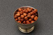 image of cobnuts  - hazelnuts in metal bowl on dark background - JPG