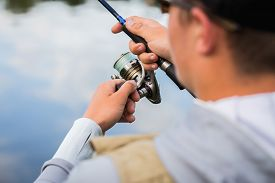 image of fly rod  - Fishing in river - JPG