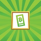 stock photo of bitcoin  - Image of bitcoin symbol on phone screen in golden frame - JPG