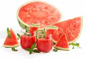picture of watermelon slices  - Glasses of fresh watermelon juice ripe watermelon and slices in background - JPG