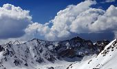 foto of snow capped mountains  - Mountains in snow - JPG