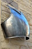 pic of breastplate  - old armor hanging on the wall of the building - JPG