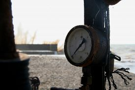 foto of manometer  - The old manometer near the sea coast  - JPG