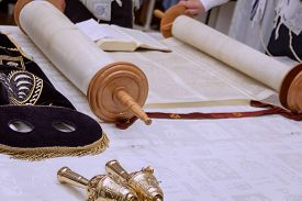 stock photo of torah  - Hebrew text of the Torah the wood parchment scroll and gold cap with a bells - JPG