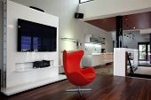 red armchair in modern apartment