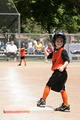 Young Child in Softball Game With Thumbs Up!
