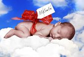 Fantasy Infant Sleeping in Clouds With Bow and Gift Tag From God