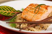 Healthy Dinner of Grilled Salmon on Bed of Rice