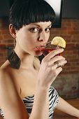 Young Woman Drinking A Martini