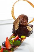 Ganache Dessert - Sweet mixture of Chocolate and Heavy Cream. Garnished with Tartufo Bianco (white t