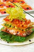Crab Meat Salad with Tomato and Avocado on Fresh Green Leaves