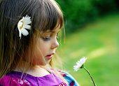 Cute little girl relaxing on a meadow