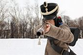 MOSCOW - FEB 27: Soldier with old gun performs at historical reconstruction, Feb 27, 2011 in Moscow, Russia. Municipality of Lefortovo and
