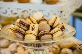 Delicious Macaroons Close-up. Delicious Sweet Buffet With Cupcakes. A Sweet Festive Buffet With Cupc poster