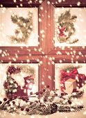 pic of old-fashioned  - Looking into a festive seasonal Christmas window as snow falls outside - JPG