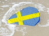 Flag Of Sweden On A Stone On The Beach Of The Baltic Sea