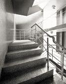 Empty concrete building stairway composition.
