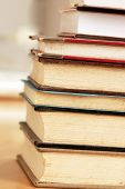stock photo of dust mites  - old dusty closed books stack on table