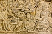 stock photo of mahabharata  - An ancient Khmer carving of the Battle of Kurukshetra showing a man being killed as described in the Mahabharata - JPG