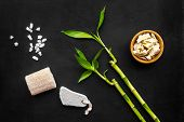 Asian Spa Background. Spa Treatment Concept. Bamboo Branch, Spa Cosmetics On Black Background Top Vi poster