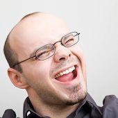 Young happy man yelling loud