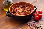 bowl with octopus in tomato sauce