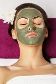 Woman With Clay Facial Mask   In Beauty Spa. Skincare. Beauty Concept. Close-up Portrait Of Beautifu poster
