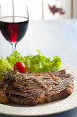 porterhouse with salad and wine