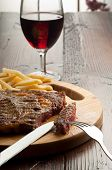 porterhouse with french fry and wine