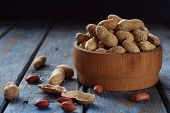 Peanuts In Nutshell And Peeled Peanut On Wooden Background. Healthy And Dietary Nutrition. Raw Food. poster