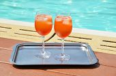 Pair of traditional Italian Spritz cocktails at the swimming pool