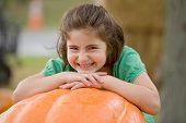 Little Girl And A Big Pumpkin