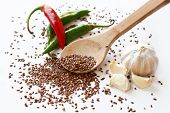 Cayenne Peppers, Flax Seeds, Coriander And Garlic On White Background
