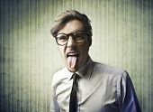 Businessman sticking out his tongue