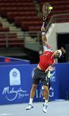 KUALA LUMPUR - SEP 28: David Ferrer (Spain) serves in his Q-final match at the ATP Tour Malaysian Open 2012 on September 28, 2012 at the Putra Stadium, Kuala Lumpur, Malaysia. He beat Igor Sijsling.