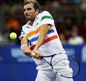 Kuala Lumpur - 28 de septiembre: Julien Benneteau 9Fra) juega su partido de cuartos de final en el ATP Tour de Malasia