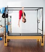 Pilates aerobic instructor woman in cadillac fitness exercise