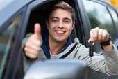 Man doing thumps-up in car