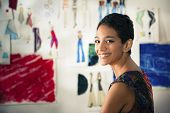 picture of self-employment  - Confident entrepreneur portrait of happy hispanic young woman working as fashion designer and dressmaker in atelier - JPG