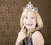 Pretty Young Girl With A Tiara With Braces