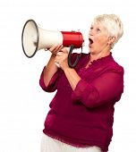 Portrait Of A Senior Woman With Megaphone On White Background