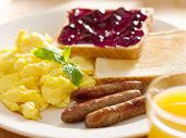 breakfast food - american style breakfast with scrambled eggs, sausage and toast.