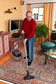 Man At Home With A Vacuum Cleaner