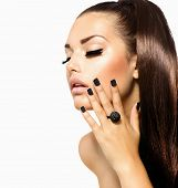 Beauty Fashion Model Girl with Long Healthy Hair, Long Lushes. Fashion Trendy Caviar Black Manicure.